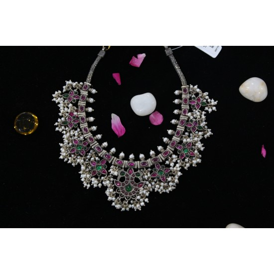 silver stone with pearl necklace
